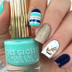 """Nautical⚓️ Excuse my thumb nail, it broke yesterday. Finally started including her in pictures and the bish betrayed me Polishes Used: ▪️Teal - @flossgloss """"Wet"""" ▪️Glitter - OPI """"My Favorite Ornament"""" ▪️Navy - Esssie """"Dress to Kilt"""" ▪AnchorCharm - @hexnailjewelry ▪️Topcoat - @salonperfect"""