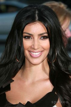 The younger Kim Kardashian.   Love the shape of her eyebrows back then.