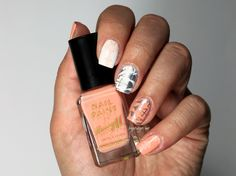 by: brijitsdigits  Pastel orange mani stamp! love the colors on her skin :)