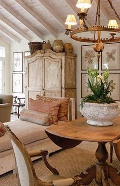 The large olive jars and baskets create a textural mass that extends the height of the armoire.