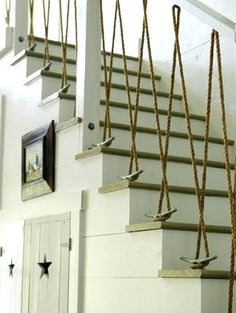 Love this rope railing and boat cleats for a #coastalstaircase! Found on Completely Coastal.