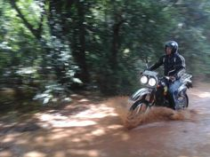 Feb-2016, Motorcycle Tour where one of the rider is crossing a small stream of water.
