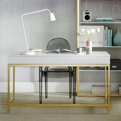 Give a plain desk a glam makeover by spraying its legs gold.  INSPIRED? Click this photo for see how...