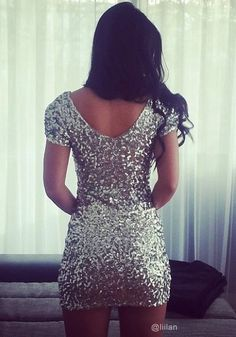 covered in Silver Sequins
