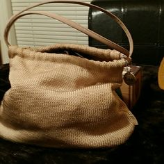 The Sake pouch purse In good condition, vintage Sak, authentic.  Tan in color. Some fuzzing of material,  a few smudges on bottom but still a great purse with very limited flaws/defects. The Sak Bags