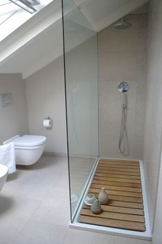 Glass shower wall, sunk-in floor even with rest of bathroom and walk-in, no door.Glass shower wall, sunk-in floor even with rest of bathroom and walk-in, no door. Wet Rooms, Attic Rooms, Attic Apartment, Apartment Therapy, Apartment Design, Loft Bathroom, Upstairs Bathrooms, Tiny Bathrooms, Master Bathroom