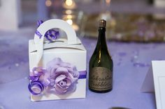 A lovely, yet simple favour box with a champagne bottle of bubbles.