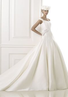 PRONOVIAS Tip-Of-The-Shoulder A-Line Wedding Dress in Mikado A tip-of-the-shoulder wedding dress in A-line silhouette with buttons down the back on the chapel train.
