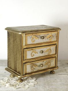 vintage golden jewelry box to put all your trooprr.com jewelry in!