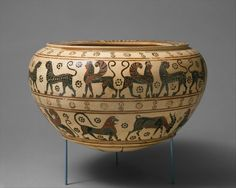 Terracotta dinos (mixing bowl) Attributed to the Polyteleia Painter   Period:     Transitional Date:     ca. 630–615 B.C. Culture:     Greek, Corinthian