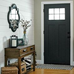 Happy Thursday!  I'm playing along for #shareitthursday to share my favorite space.  Those who have been following for awhile probably could have guessed that my entryway is my absolute favorite space in our home.  It includes everything I love!  From the painted craftsman door and plank wall to the wood tones and cotton sprigs!  I wouldn't change a thing! (Wall color-@sherwinwilliams Balanced Beige, door color- SW Iron Ore)