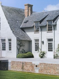 house with white painted brick Classical Architecture, Beautiful Architecture, Residential Architecture, New England Style Homes, White Brick Houses, Belgian Style, Tudor House, Amazing Buildings, Mansions Homes