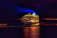 Cruise ship in motion leaving Cozumel harbor, Mexico, at night - I think that this long exposure photo of the boat slowly moving into the dark makes a kind of mysterious scene...