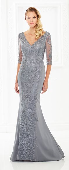 This sophisticated crepe mermaid gown with three-quarter lace illusions sleeves features a bodice covered with embroidery that cascades down the center front and back skirts. Front and back V-necklines and a sweep train round out the design.