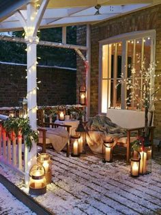 Cozy porch in the Winter, lit by candles and Christmas lights