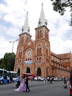 Bride in the street – The Nhà Thờ Đức Bà Sài Gòn (Saigon Notre-Dame Basilica), Ho Chi Minh City (Saigon), Vietnam, besides being a place of worship, is also a very popular destination as a backdrop for couples wedding photographs. #wedding #BrideAndGroom #NhàThờĐứcBàSàiGòn #SaigonNotreDameBasilica #HCMC #church #cathedral #HoChiMinhCity #Saigon #Vietnam #everybodystreet #lensculture #streettog #travelblogger #travelphotography #NicksWanderings