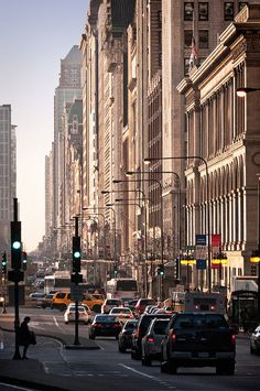 "morning rush hour, Historic Michigan Boulevard District, Chicago, Illinois      ""Michigan Avenue Streetwall"" aka ""The Cliff"" • designated Chicago Landmark, 2002 • placed on National Trust for Historic Preservation's 11 Most Endangered Places list, 2008"