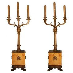 Marvin Alexander,Inc. Bronze and Sienna marble three light torcheres mounted on four paw foot bases with mask medallions and handles, France 19th century