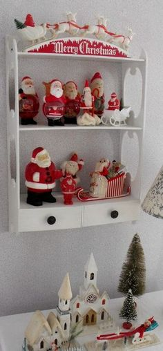 I love this! Cute way to display your vintage Santa collection...