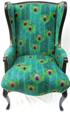 Peacock printed fabric with black arms and legs. Love painted furniture. this chair is a stunner in blue, aqua, turquoise and green colours
