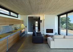 House in Kea is a concrete home built around trees on a Greek isle