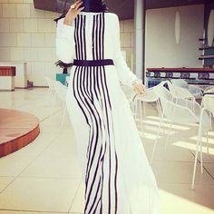 This dress is for the woman who loves simplicity.  Usually, I would add a pop of color to a black-and-white ensemble, but if I were wearing this dress for Eid, a zebra-striped sunhat would be all I need. - Habiba West