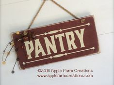 This is a handmade, distressed, wooden country sign that says PANTRY with a rusty star and garland attached. Color – Barn Red with Antique White lettering  There is natural Jute cord through the sign for hanging. It comes ready to hang. The sign measures approximately 12 inches x 5.5 inches. It is made to appear old, antique, or vintage. It would be a great addition to any rustic, country, primitive, or farmhouse decor. This item is solid wood and handmade to order. Please be aware that…