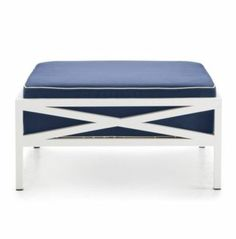 Make a statement on your patio with a nautical-inspired white and navy ottoman.