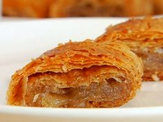 Mamo's Apple Strudel Duff Goldman / uses paper thin phyllo dough for the crust with an interesting addition of bread crumbs. Just Desserts, Dessert Recipes, Frozen Desserts, Dessert Ideas, Delicious Desserts, Breakfast Recipes, Food Network Recipes, Cooking Recipes, Healthy Recipes