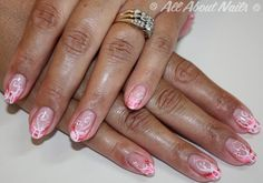 Cute pink hand painted sculpted gel nails done at www.allaboutnails.org