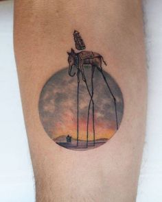 Salvador Dalís Elephants inspired tattoo on the...