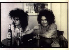 Wonderful and ridiculous and rare (Bob without lipstick or eyeliner!) pic of Simon Gallup and Robert Smith of the Cure...the HAIR! Amazing.