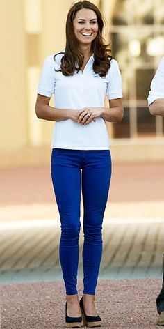 Kate Middleton wore cobalt skinny jeans, a polo shirt, and cork Stuart Weitzman wedges at the Olympic torch relay at Buckingham Palace.