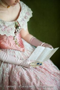 Trevillion Images - close-up-victorian-woman-reading-letter