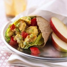 Curried Chicken Salad Wraps - 1/2 cup fat-free or low-fat mayonnaise dressing or salad dressing  1/2 teaspoon curry powder  1/8 teaspoon ground black pepper  2 cups chopped cooked chicken breast (about 10 ounces)  1/4 cup sliced green onions  4 romaine leaves or 8 fresh spinach leaves   4 7 - inches whole wheat flour tortillas  1 medium tomato, chopped Cover and chill for 2 to 24 hours. Place a romaine leaf or two spinach leaves on each tortilla. Top with chicken mixture and tomatoes. Roll…