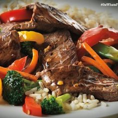 Asian Beef and Vegetable Stir Fry 1 1/4 lbs boneless beef steak, cut 1 inch thick 4 c fresh veggies. 1 clove garlic, minced 1/2 c prepared stir-fry sauce1/8 to 1/4 tsp crushed red pepper. Cut beef lengthwise in half, then crosswise into 1/4-inch thick strips. Combine veggies and 3 Tbs water in large skillet. Cover/cook on med-hi heat 4 min or til crisp. Drain. Add beef and of garlic; stir-fry 1-2 min or til outside of beef isn't pinkt. Return all to pan. Add sauce and red pepper.