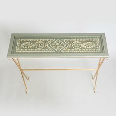 Gold console table with shell design