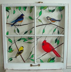 Stained glass bird inserts in an old window; or you could paint this on a window