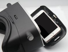 """VR KiX ~ Virtual Reality Glasses.  Shown here with the adjustable smartphone tray open.  Spring loaded tray keeps your phone securely in place.  It will not rattle or move during use.  Can accommodate phones with screen sizes from 3"""" to 6""""."""