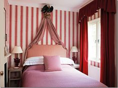Nicky Haslam ~ red and white striped guest room in his country folly which is the former home of John Fowler.