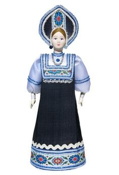 large porcelain Russian doll Nastenka in traditional handmade costume