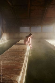 Woman relaxing at Japanese hot springs by Trinette Reed