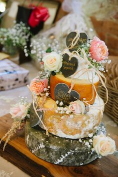 An alternative to the wedding cake....a cheese stack.... delicious! I decorated this one with #peachroses and #coralroses to co ordinate with the bridal flowers. http://www.cheeseshop-nottingham.co.uk/