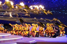 Flame out...Performers watch as the Olympic flame is extinguished during the closing ceremony in London Sunday night. It will next be lighted for the Summer Games in four years in Rio de Janeiro.