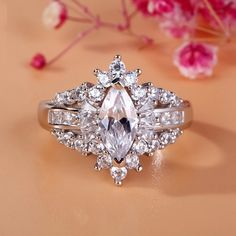 Jeulia Luxurious Unique Halo Marquise Cut Created White Sapphire Engagement Ring - Jeulia Jewelry - June 01 2019 at Engagement Ring Settings, Vintage Engagement Rings, Art Deco Jewelry, Fine Jewelry, Jewelry Model, Natural Emerald Rings, Silver Rings Online, Bridal Bracelet, Diamond Wedding Rings
