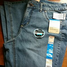 """JMS Stretch Bootleg Jean 16W A NWT pair of Just My Size jeans size 16W Average. Stickers and tags attached state """"Fit solution slimming panel with lockstitch control; contoured waistband for no gap comfort; modern fit sits below the natural waist; fits closer through hip and thigh""""  Inseam 31"""". Leg opening 20"""". Labeled stretch boot leg. 73% cotton 28% polyester 2% spandex JMS Jeans Boot Cut"""