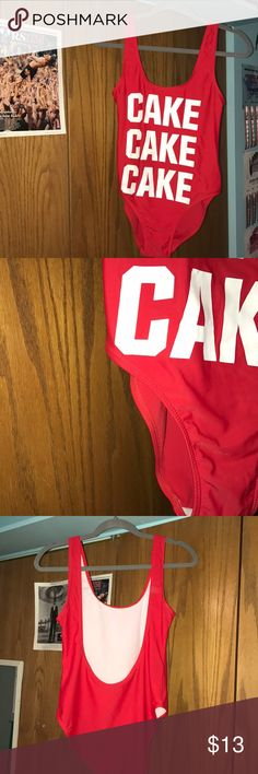 """Cake red one piece """"CAKE CAKE CAKE"""" red one piece. Not high waisted, and has a low back. Size Medium, brand is yerenlian. Looks cool with shorts in the summer or just simply as a one piece. yerenlian Swim One Pieces"""