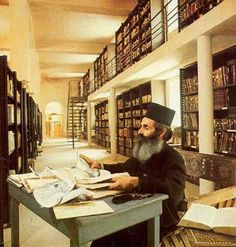 A monk in the library of the monastery of St. Catherine in Egypt. The library holds a collection of 4,500 manuscripts.