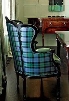 a cool graphic tartan that juxtaposes the curvy feminine lines -- wing chair used as host chair in the dining room (Design by Summer Thornton, via Chicago Home & Garden)