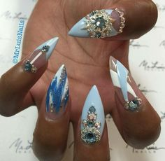 Blue and white stiletto nails with gold gems